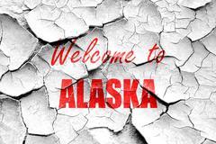Grunge cracked Welcome to alaska - stock illustration