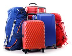 Suitcases and rucksacks isolated on white - stock photo
