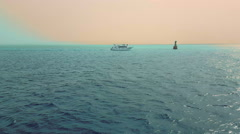 The yacht is moving in the azure sea - stock footage