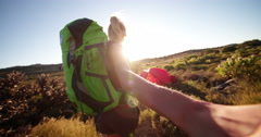 Girl hiker leading her boyfriend by holding hands to tent Stock Footage