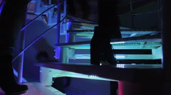 Beautiful people entering nightclub. Climbing stairway. Relaxation, enjoyment Stock Footage