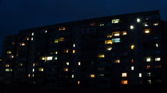 Multistorey Building with changing Window Lighting at Night. Time Lapse Stock Footage