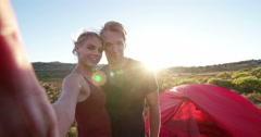 Outdoor couple taking sunset selfie while camping on hiking vacation Stock Footage