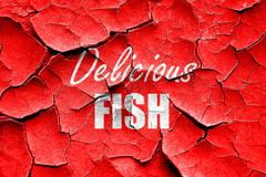 Grunge cracked Delicious fish sign - stock illustration
