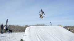 Skier 360 off jump during big air contest - stock footage