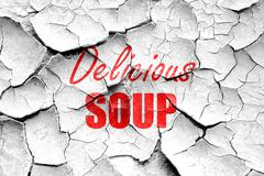 Grunge cracked Delicious soup sign - stock illustration