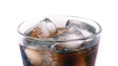 Glass Of Coke And Ice Rotating - stock footage