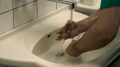 Surgeon washes his hands Stock Footage