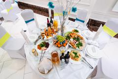 Table with food and drinks for gala dinner in restaurant Stock Photos