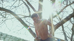 Workout at the horizontal bar in the morning Stock Footage