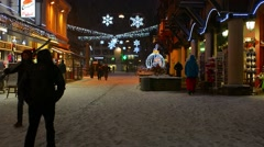 Stock Video Footage of People walking down street while it's snowing in Chamonix
