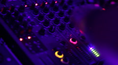 Audio equipment, DJ pushing mixing console buttons, mixing. Party atmosphere Stock Footage