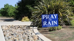 """Pray for Rain"" sign Stock Footage"