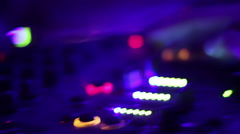Deejay's hands pushing and turning buttons on the mixing console. Nightclub - stock footage