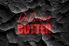 Grunge cracked Delicious butter sign Stock Illustration