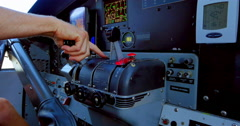 4K Pilot's Hand on Engine Throttle, Airplane Cockpit Stock Footage