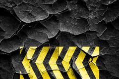 Grunge cracked Black and yellow hazard stripes - stock illustration