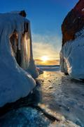 Sunset over ice covered Baikal - stock photo