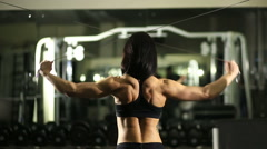 Girl in the gym. Weight training. Work on the muscles of the back. bodybuilding Stock Footage