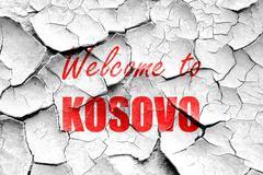 Grunge cracked Welcome to kosovo - stock illustration