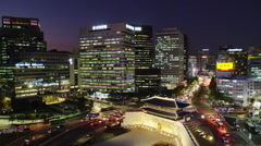 Elevated View of Early Evening Traffic at Namdaemun Gate in Time Lapse Stock Footage