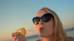 Having fun on vacation with blowing bubbles - stock footage