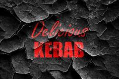 Grunge cracked Delicious kebab sign Stock Illustration