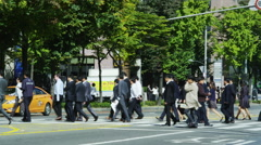Bankers crossing Yeouinaru-ro during Lunch Break Stock Footage