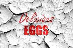 Grunge cracked Delicious egg sign - stock illustration