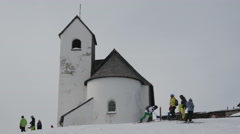 Skiers near a building with old architecture, Kitzbühel Stock Footage