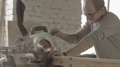Professional carpenter cut long wooden board by circular saw. Furniture Stock Footage