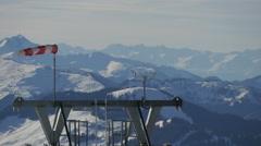 Wind indicator waving in the wind at Kitzbühel ski resort Stock Footage