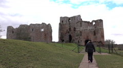 Brougham Castle ruins woman walking England 4K Stock Footage
