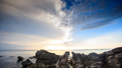 Rocks by Beach Sunlight Reflection in Sea at Sunset Stock Footage