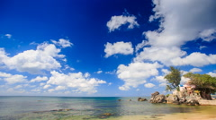 Cumulus Clouds Motion above Azure Sea Rocky Beach Stock Footage