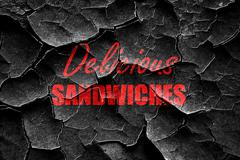 Grunge cracked Delicious sandwich sign - stock illustration