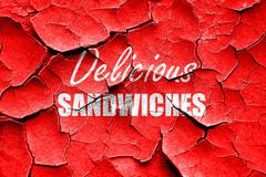 Grunge cracked Delicious sandwich sign Stock Illustration
