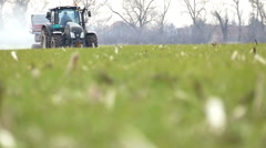 Spring works in the field of young wheat Stock Footage