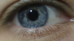 Video of a man opening his blue eye - stock footage