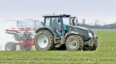 Fertilization of wheat Stock Footage