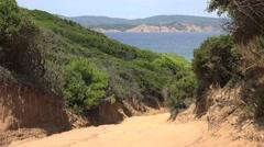 4K Aerial view Skiathos wild beach narrow road seascape green vegetation daytime Stock Footage