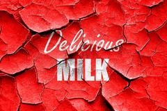 Grunge cracked Delicious milk sign Stock Illustration