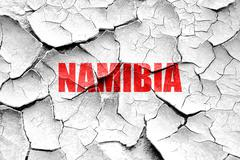 Grunge cracked Greetings from namibia - stock illustration