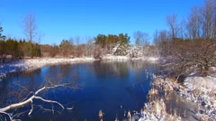 Moving through wilderness, over thin ice of frozen, scenic lake Stock Footage