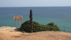 4K Agistros beach taverna signage Skiathos island exotic holiday touristic place Stock Footage