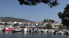 4K Famous Skiathos old town tranquil vessel port yacht anchor traffic street day Stock Footage