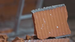 Brick break. Brick smash them with a hammer into small pieces - stock footage