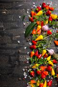 top view of garlic, dry and colorful peppers, sea salt, different greenery on - stock photo