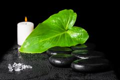 beautiful spa concept of Yin-Yang stone texture symbol, green leaf with dew,  - stock photo