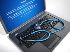 Stethoscope on laptop computer with a blue screen error on the display - stock illustration